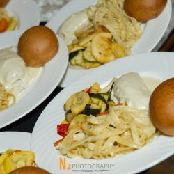Dinner plates with pasta and rolls at our reception hall - Alegria Gardens