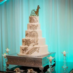 Wedding cake with floral designs at our reception hall - Aledgria Gardens
