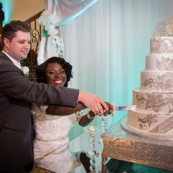 Couple cutting the cake at our reception hall - Alegria Gardens