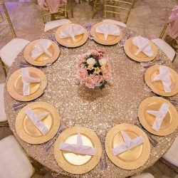 White table with gold plates at our wedding venue - Alegria Gardens