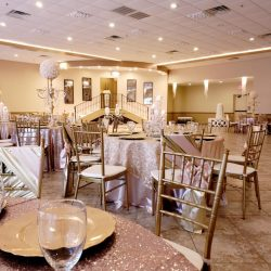 A picture featuring beautifully decorated tables and chairs inside of Alegria Gardens Reception Hall at Stacy in Houston.