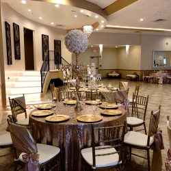 A picture of a decorated dining table inside Alegria Gardens Reception Hall at Stacy in Houston.