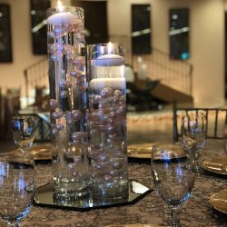 A close-up shot of table decorations at Alegria Gardens Reception Hall at Stacy in Houston.
