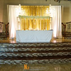 A photograph of a raised platform with a wedding table taken at Alegria Gardens at 529 in Houston.