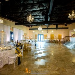 A picture of the dining hall at Alegria Gardens at 529 in Houston featuring beautifully decorated tables.