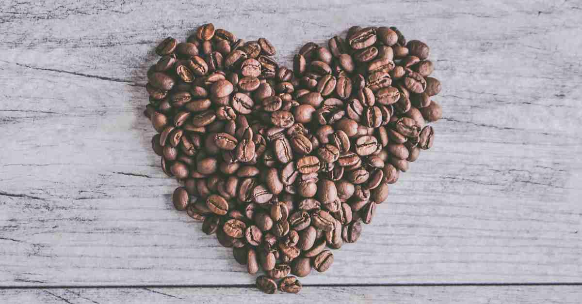 Coffee beans arranged into shape of a heart