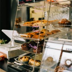 Muffins, scones, and pastries inside clear case