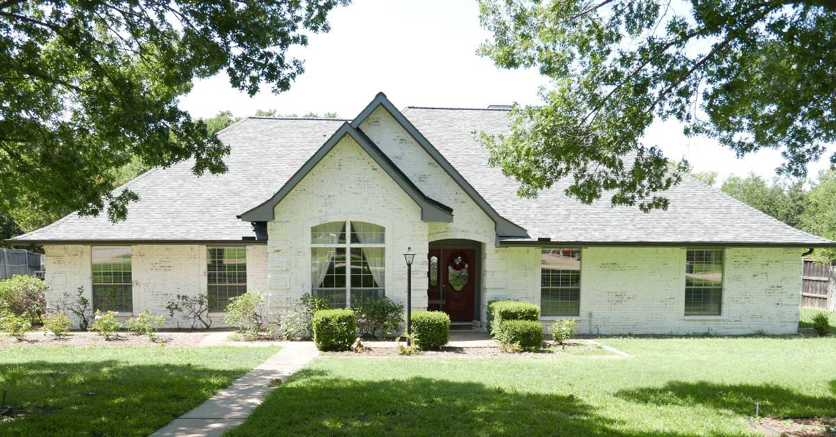 Image of the exterior of a beautiful limewashed brick home in the Dallas-Fort Worth Area