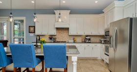 Modern kitchen with light blue walls and white cabinets