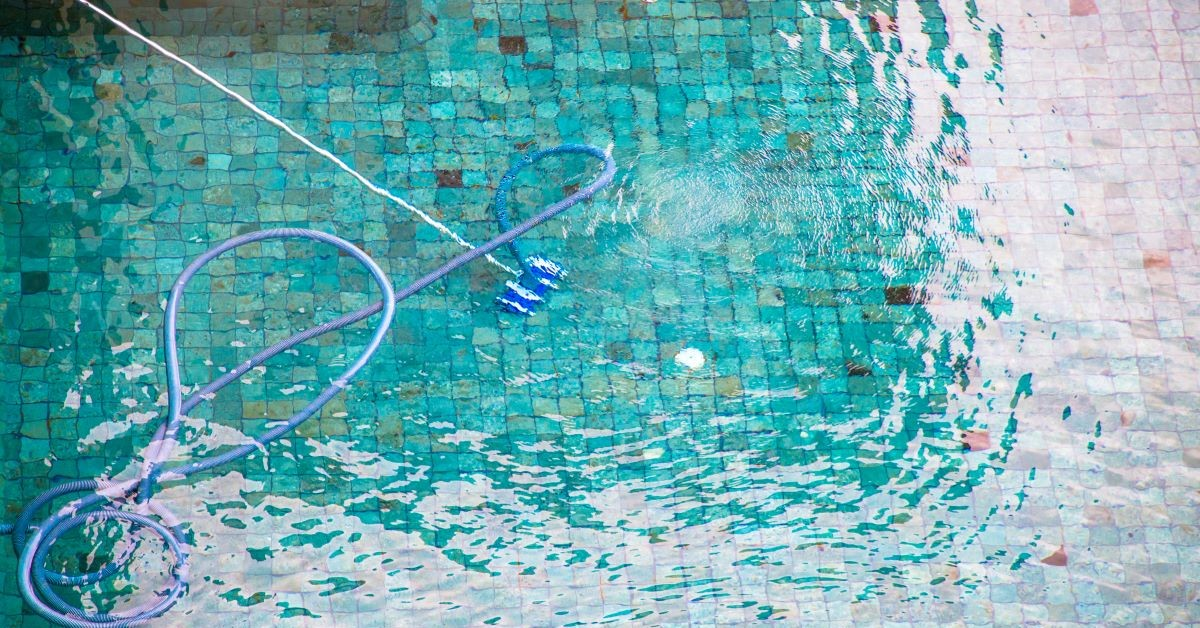 pool vacuum cleaning a pool