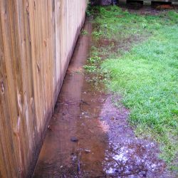 Water Pooling Near Fence