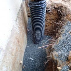 Drainage Pipe Installation in Gravel