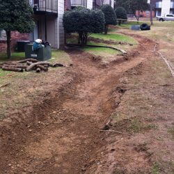 Passive Drainage Trench Installation at Rental Property