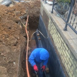 Digging Trench for Waterproofing Foundation Barrier