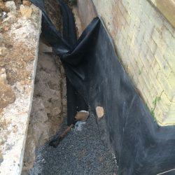 Installing Waterproof Barrier Around Home Exterior