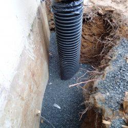 Drainage Pipe Installation Around Building Exterior