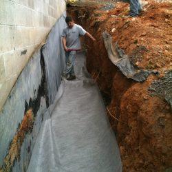 Installing Protective Waterproof Barrier Around Home