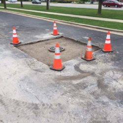 Our asphalt repair company in Bridgeview working on sewer repair