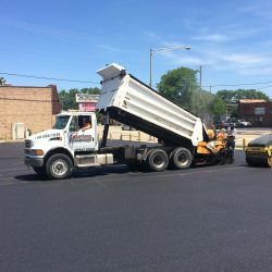 Teamwork! We work together when asphalt paving in Bridgeview for the best job possible!