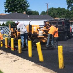 This asphalt driveway in Bridgeview is about to look fantastic