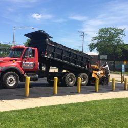 American Sealcoating & Maintenance working on an asphalt parking lot in Bridgeview