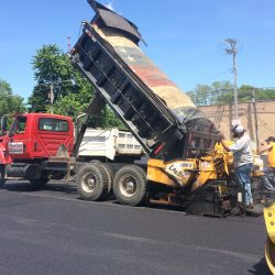 American Sealcoating & Maintenance always follows safety protocols when asphalt paving
