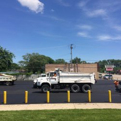 American Sealcoating & Maintenance working hard at asphalt paving in Bridgeview