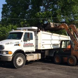 A day on the job of an American Sealcoating & Maintenance asphalt contractor