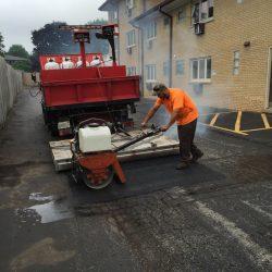 An American Sealcoating & Maintenance asphalt contractor working in Bridgeview