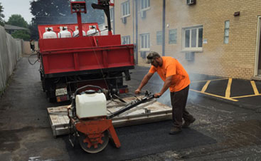 Asphalt blacktop job by American Sealcoating & Maintenance