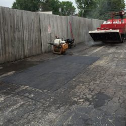 American Sealcoating & Maintenance working on asphalt paving