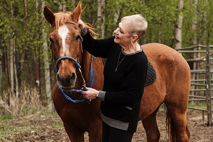 Karen P. petting horse