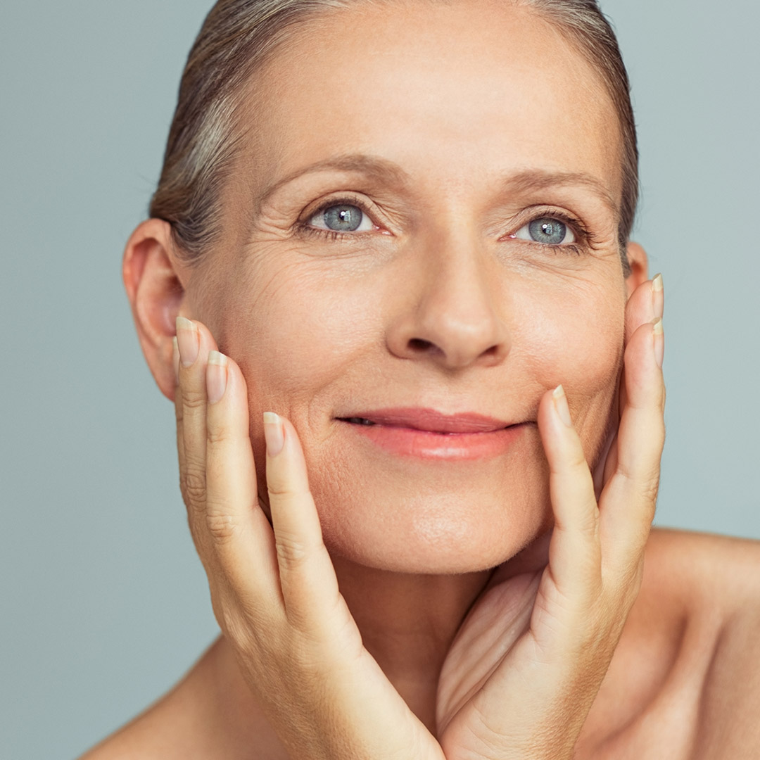 Portrait of mature woman with perfect skin thanks to ANYASolutions Med Spa Denver