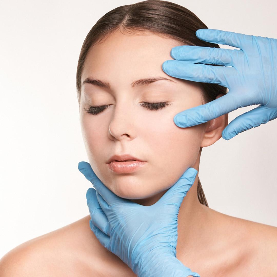Cosmetologist apply mentoplasty offered at ANYASolutions Med Spa Denver