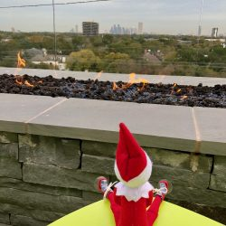 On the pool deck there is a fireplace with an amazing view of the Texas Medical Center
