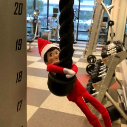 Hanging from the pull down bar in the fitness center