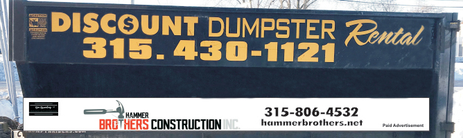 A dark blue, large dumpster from our dumpster rental service.