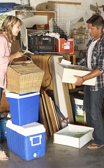 A man and a woman pack up the garage.