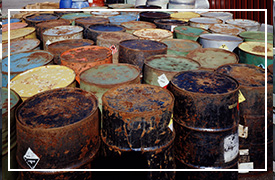 An image of old rusty metal barrels.