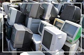 A heap of old computer monitors.