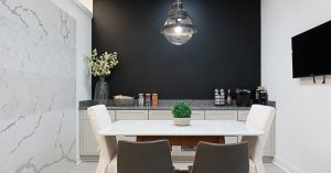 showroom photograph featuring natural stone countertop, wall accent piece
