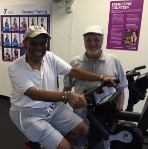 Supports Michael on exercise machine with Wade