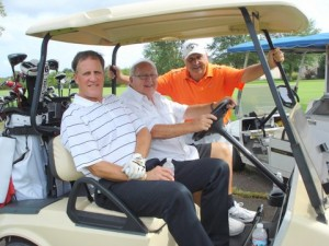 Golf - Herb threesome in cart