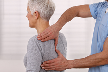 Woman getting chiropractic care