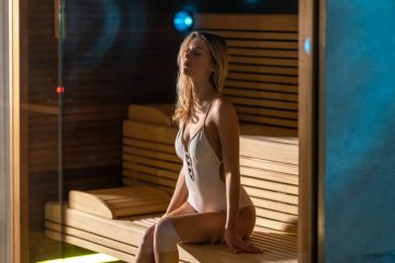 Image of a woman sitting in a sauna.