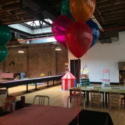 Image of the Art Farm NYC's class area set up with tables, chairs, and balloons for Mornings On the Farm.
