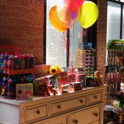 Image of balloons and other children's toys inside of the Art Farm NYC's toy store.