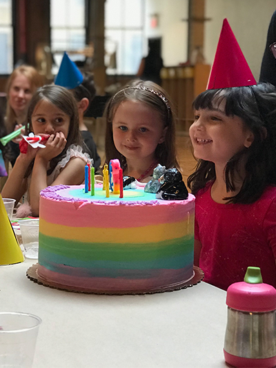 Picture of a young girl smiling during a birthday party at The Art Farm NYC.