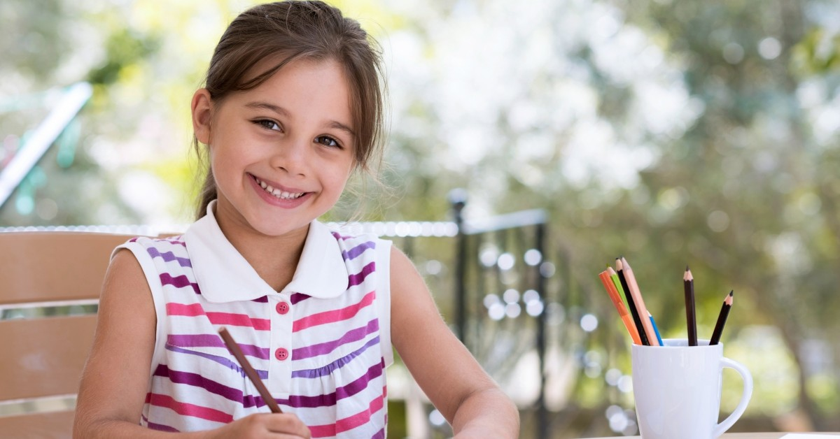 Image of a young girl smiling.