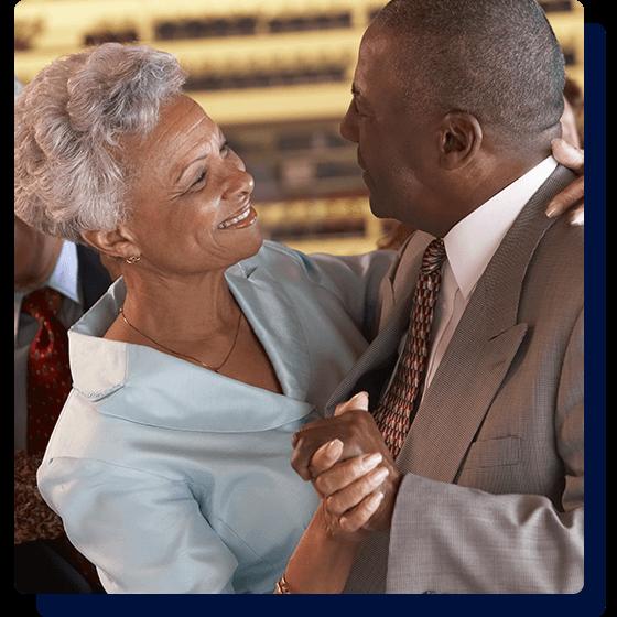 an image of an older couple having fun dancing